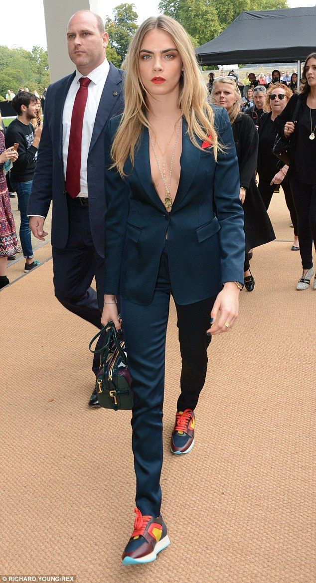 Braless in a two piece navy suit, teamed with a pair of trainers and scarlet lips. Brilliant!