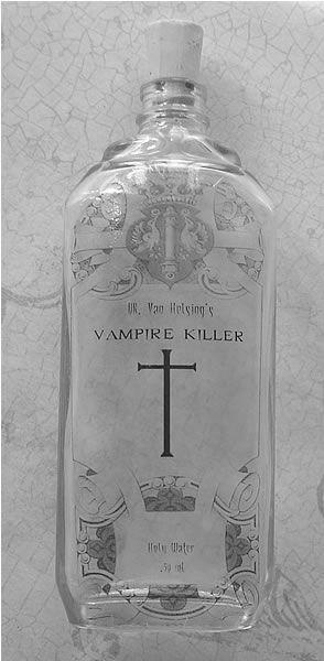 "hmmm....remove label. use glass etch. add cross. fill w/ ""holy water""....check!"