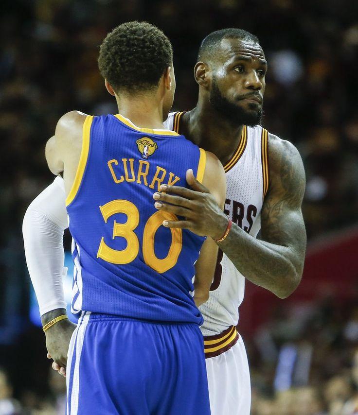Cleveland Cavaliers' LeBron James congratulates Golden State Warriors' Stephen…