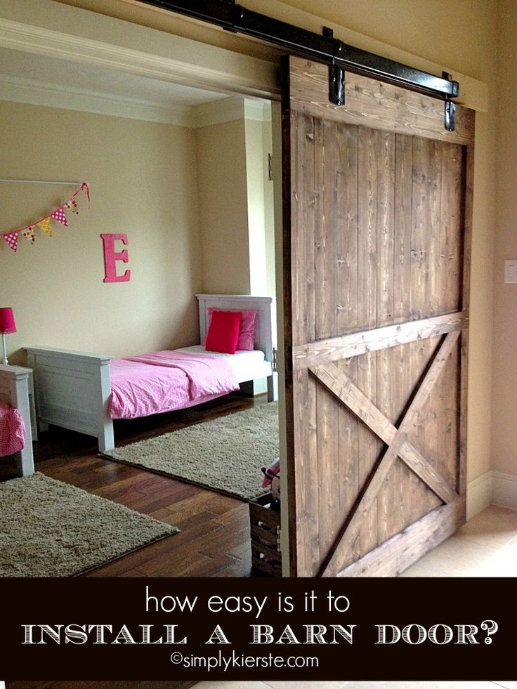 How easy is it to install a sliding barn door?  Tips, resources, and answers to all your questions!  #simplykierste #slidingbarndoor #diy