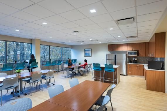 The building-wide shared staff lounge takes advantage of ...