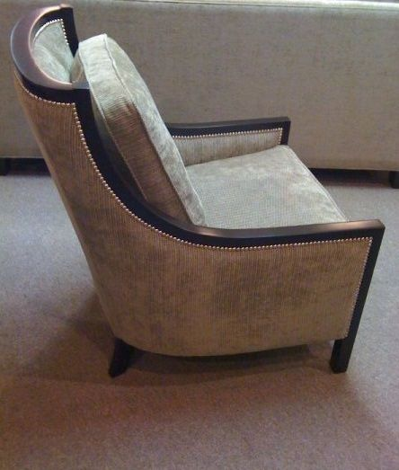Custom made chair with a wooden frame.