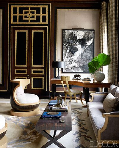 A 1940s-style sofa covered in a Pierre Frey suede, an Art Deco cocktail table, and a chair by Deniot in the husband's bedroom; the painting ...