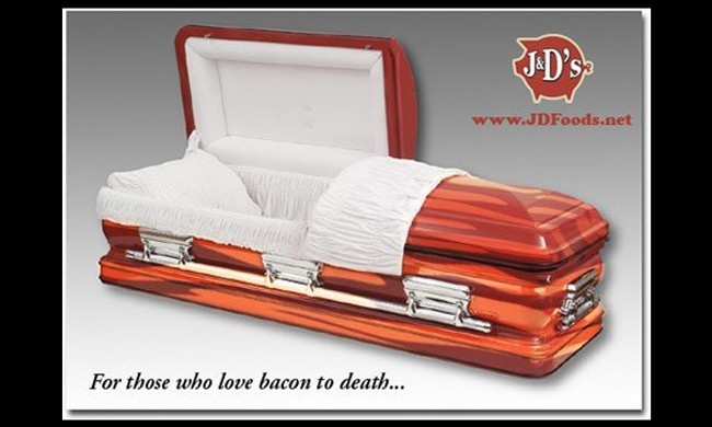 "Words escape me >>> J's Bacon Coffin isn't actually made of bacon, it's painted with bacon and pork shading and comes equipped with a ""bacon air freshener for when you get that buried-underground, not-so-fresh feeling."""