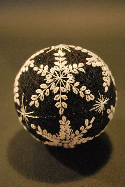 Temari, is a Japanese thread ball.  They are given as tokens of good luck.