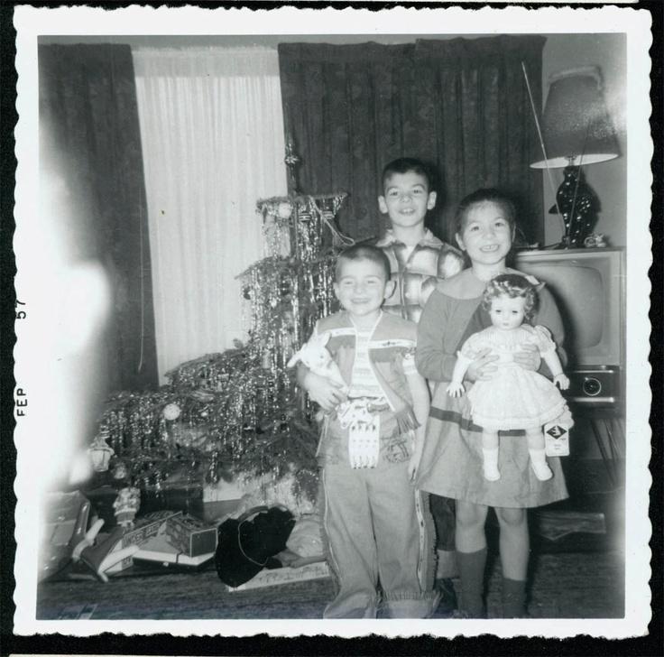 Vintage photo Christmas Morning Children w Toys Doll by Tree 1957. $5.50, via Etsy.