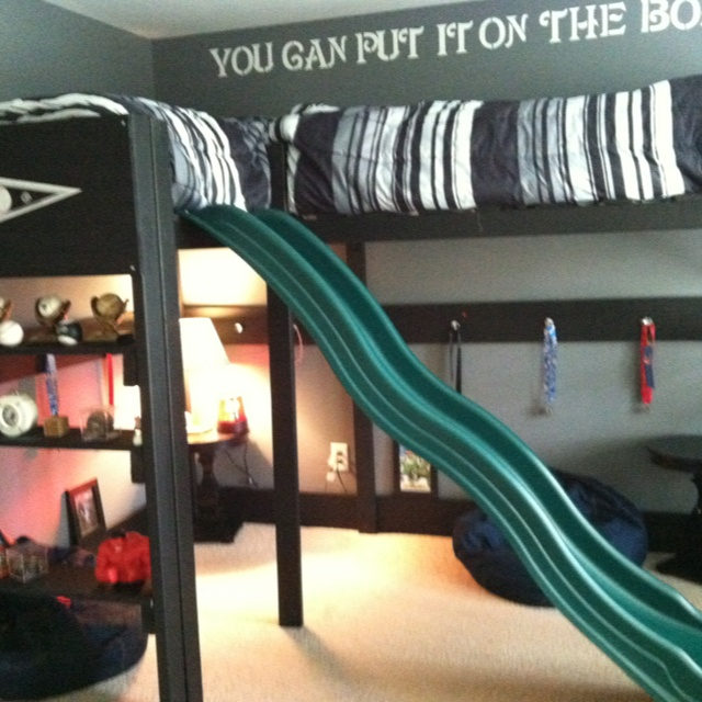 Boys loft bed. Loft/bunk slide. Drawer pulls on support boards to hang medals, phitens, necklaces, or whatever. Twin boys room in Chicago White Sox theme. Loft self built. 2 Standard twin mattresses.