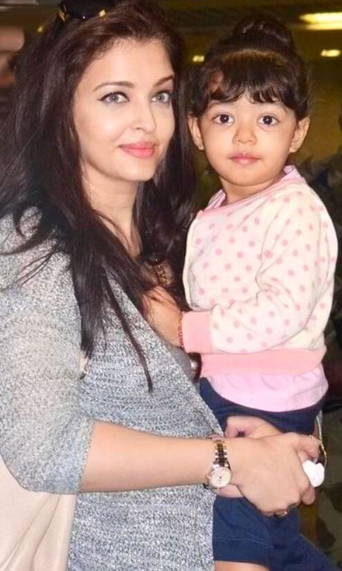Aaradhya Bachchan was spotted at the airport in her mum Aishwarya's arms on their return from Dubai this weekend. The tiny tot, who recently turned 2, looks super-cute as she resembles dad Abhishek, but of course she has her mom's beautiful complexion.  Ahead: Daadu Amitabh Bachchan at Agastya and Aaradhya's birthday.   (This image was posted on Twitter by Aishwarya Rai - FC)