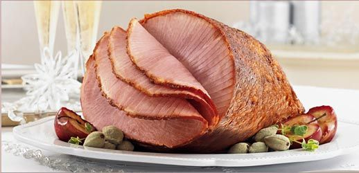 Honey Baked Ham.... We buy it every year & mom makes the most amazing pineapple-clove glaze! Christmas!