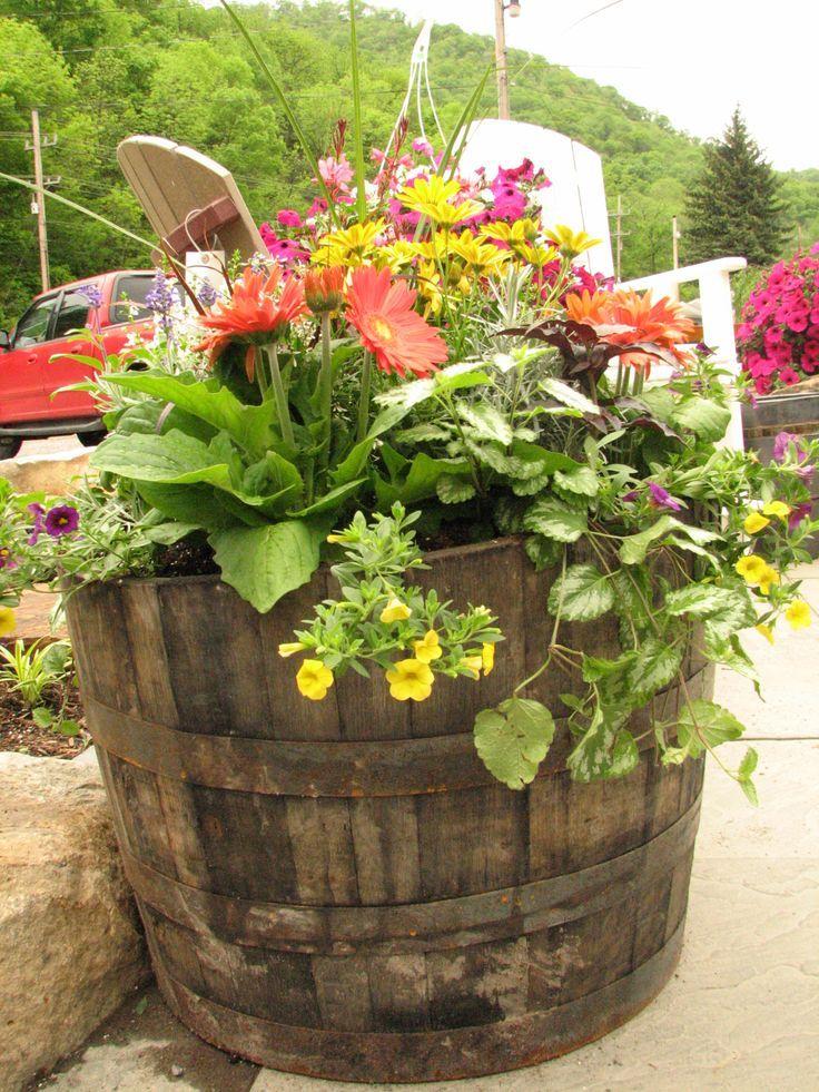 Whiskey barrel planter garden ideas pinterest for Wooden barrel planter ideas