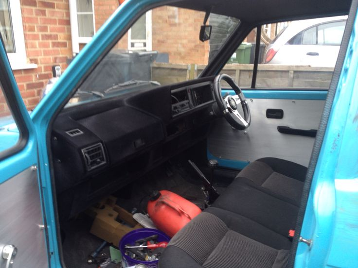 Flocked dash, three seater conversion and alloy door cards (photo taken during mods)