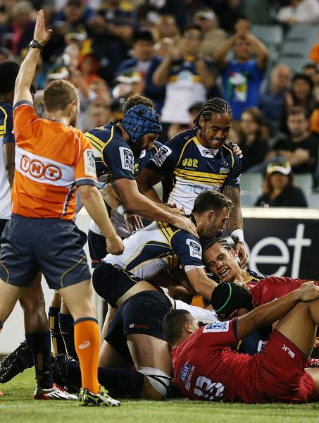 Scott Fardy Photos - Matt Toomua of the Brumbies is congratulated by team mates after scoring a try during the round one Super Rugby match between the Brumbies and the Reds at GIO Stadium on February 13, 2015 in Canberra, Australia. - Super Rugby Rd 1 - Brumbies v Reds