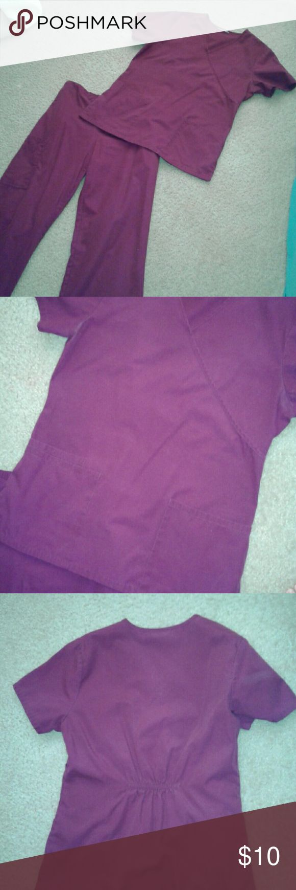 Maroon/wine scrubs Beautiful maroon/wine color.  Pictures look purple, but the color is more maroon/wine looking. Excellent used condition.  No holes or tears. Size says XS, but it fits like a small.  I'm 130 lbs and it fits me perfect. SB Scrubs Other