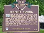 The Great Serpent Mound is a 1,348-foot (411 m)-long,[2] three-foot-high prehistoric effigy mound located on a plateau of the Serpent Mound crater along Ohio Brush Creek in Adams County, Ohio. Maintained within a park by the Ohio Historical Society, it has been designated a National Historic Landmark by the United States Department of Interior. The Serpent Mound of Ohio was first reported from surveys by Ephraim Squire and Edwin Davis in their historic volume Ancient Monuments of the…