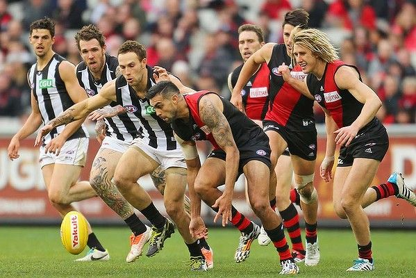 Magpies Scott Pendlebury, Dane Swan and Brent Macaffer try to get to the ball before Courtenay Dempsey of the Bombers does.