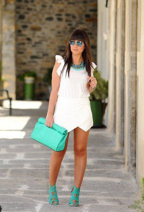 All white outfit with neon aqua and turquoise accessories