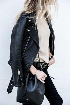 {Leather jacket and bucket bag.}