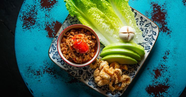 Make nam prik ong, a fiery chile dip from Northern Thailand's Chiang Mai region made with dried chiles, pork and tomatoes.