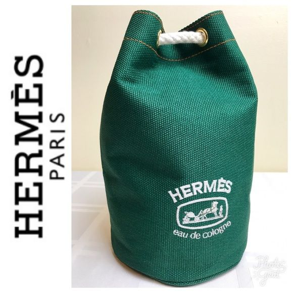 """Hermès Parfum Signature Cospemtic Travel Bag Hermès Parfum Signature Cospemtic Travel Bag in Beautiful Evergreen Canvas with White Embroidered Logo and White Rope Drawstring, Measures 6 1/2"""" in Diameter and 10"""" Tall, Used in Excellent Condition Hermes Bags Cosmetic Bags & Cases"""
