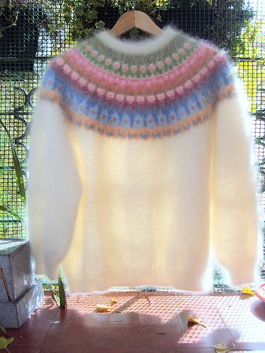 """Blue Shimmer pattern from 'Poems of Color' book. """"Choice of colors my own: white by Fonty and colors by Bouton d'Or (all angora and wool). Needles 3mm (ribbing), 3.5mm (yoke) and 4 mm (body and sleeves)."""" Posted on Flikr by Ponto e virgula"""