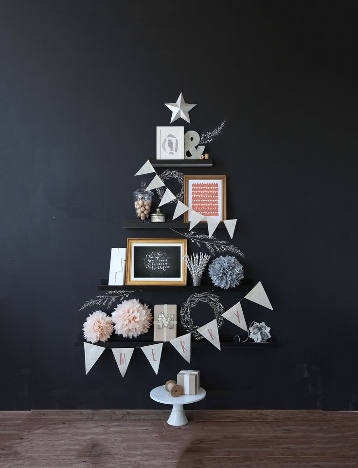 Create a Christmas Tree on your wall with decorative elements like bunting, Christmas cards, family photo's, your favorite minted art, and more.