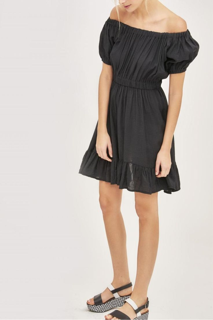 Short frilled dress, neck wear elasticized to wear on shoulders or at neck, puffed sleeves finished with an elastic at cuff, elastic at waist.    Ruffle Black Dress by Brigitte Bardot. Clothing - Dresses Miami, Florida