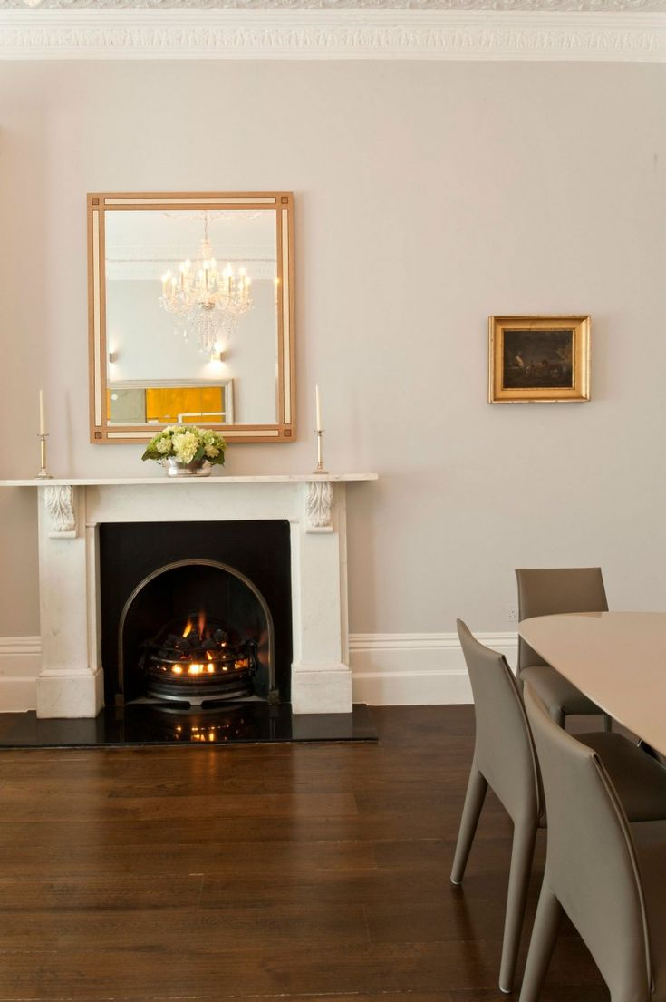 Gardens House with Fireplace Applied Darkwood Floor and Grey Painted Wall Idea
