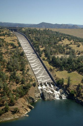 "Aerial view showing water running dow the Oroville spillway at Lake Oroville, California. Also showing the ""energy disipators"" at the bottom of the spillway."