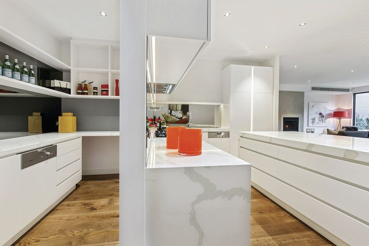 Fabulous luxury kitchen featuring Calacatta marble island bench &, smoky mirrored splashback by custom home builder Atkinson Pontifex