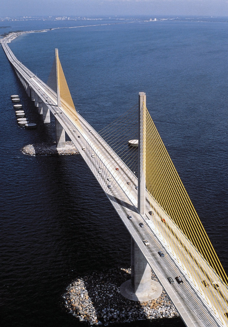 "An aerial of the Sunshine Skyway, on the Gulf coast of Florida. This bridge spans Tampa Bay with a total length of 4.1 miles. It has been rated number 3 of the top 10 bridges in the world. Because of its height above the emerald green Gulf waters, length of continuous travel, location in ""the south"" and modern architectural design, it is a popular spot for filming automobile commercials."