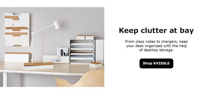 White file folders hung on the wall with IKEA KVISSLE cable management boxes and a white desk lamp