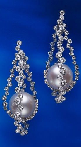 "Inspired by Johannes Vermeer's ""Girl with a Pearl Earring"" Circa 1665: Mikimoto 16mm White South Sea Pearl Earrings Featuring 7ct of Diamonds in 18k White Gold Displayed at the Masterpieces from the Royal Gallery Mauritshuis Exhibition"