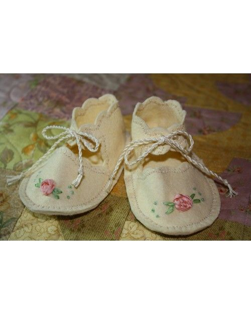 """Trishgim crafted these wool felt baby shoes from a vintage pattern. """"I did all the work with my sewing machine except the silk ribbon embroidery,"""" she says. """"The ties were made with embroidery floss that was twisted into a cord."""""""