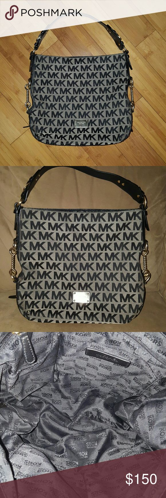 Michael Kors Signature Joplin Black Shoulder Bag Gorgeous bag from Michael Kors in black. Leather trim. Brushed silver hardware.  Center magnetic closure with large inside.  Plate has a few minor scuffs. Corners have a little wear. See pic 4.  Inside is beautiful with a zipper pocket and 4 small pockets.  Exterior and Interior has been professionally cleaned. Michael Kors Bags Shoulder Bags
