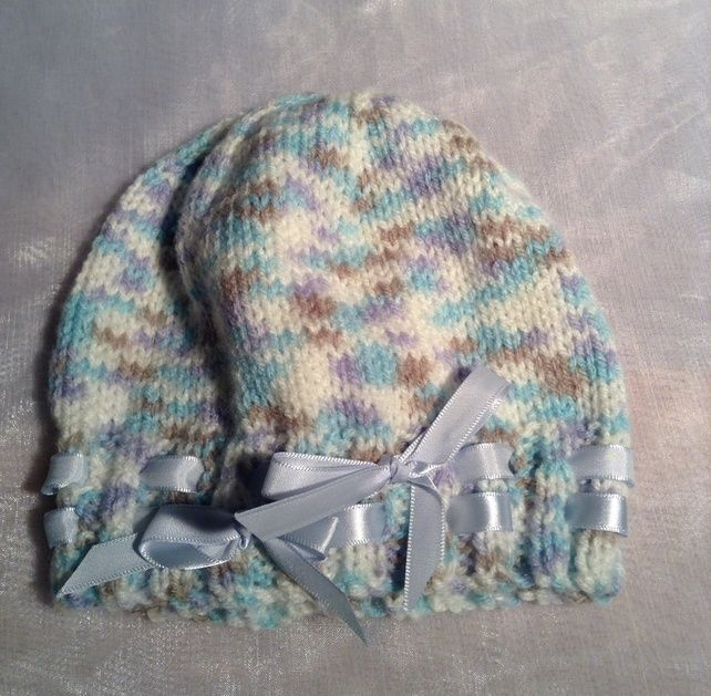 Little spotty knitted baby hat with ribbon £4.50