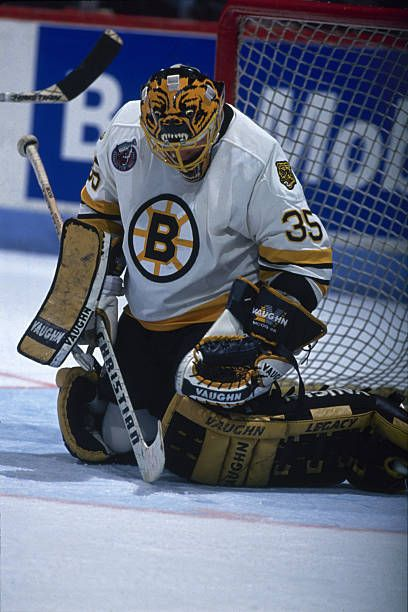 Canadian ice hockey player Andy Moog goalkeeper for the Boston Bruins guards the net during a game April 1993