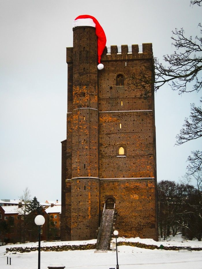 2014 will be the third year that the city of Helsingborg christmas decorate the medieval Kärnan with a giant santa hat