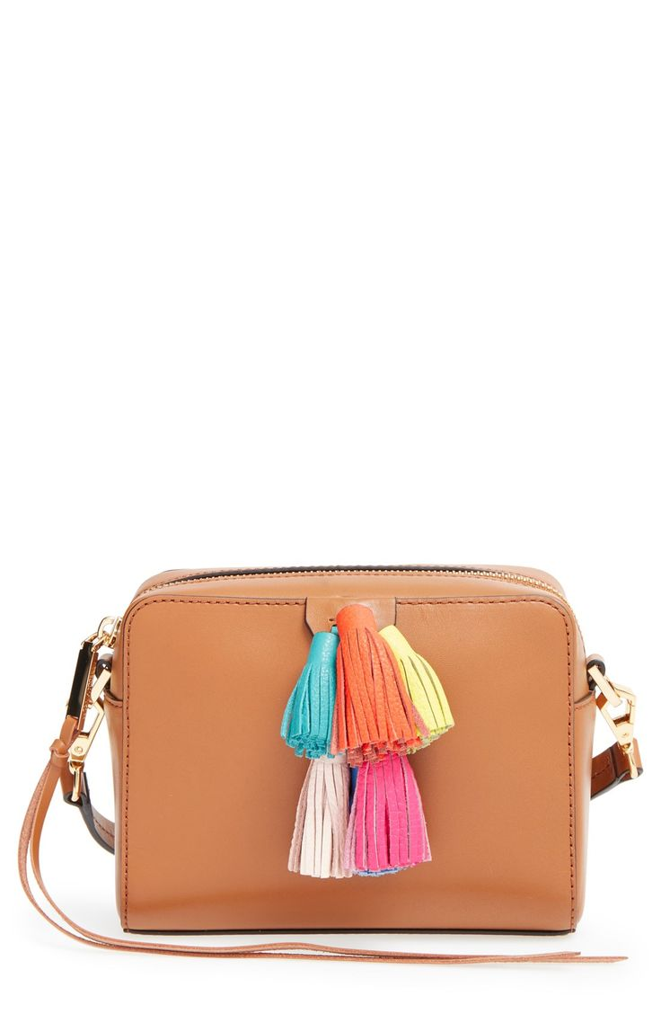This brown leather crossbody bag by Rebecca Minkoff includes adorable and colorful tassels for a festive look.