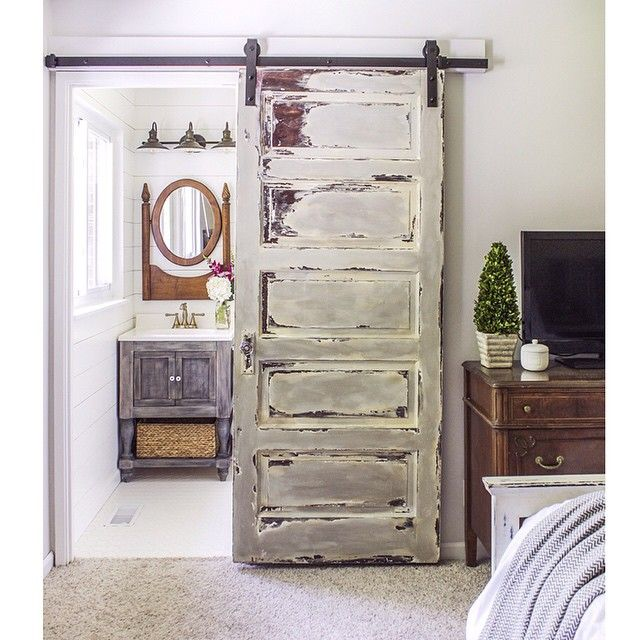 I love sliding barn doors-- especially for small spaces. They add more usable space and create a beautiful focal point.  Today I'm sharing tips and tricks on installing one plus I share how I achieved the finish on the door... (It used to be painted plain white) #barndoor #masterbathroommakeover #cottagestyle #reclaimed