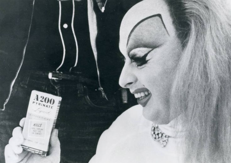 Wow! Super scarce ORIGINAL press photo for PINK FLAMINGOS!  Divine as Babs Johnson with her lice medicine. Marked as PF3, dated 1973 by Saliva Films. This item is an INSTANT DOWNLOAD and is a high resolution scan of an original photo. What you will get will be a file that is printable on photo paper which will give you an exact replica of the original still without having to pay the cost for this rare item.  Your instant download will not have words typed on it.    INTERNATIONAL BUYERS…