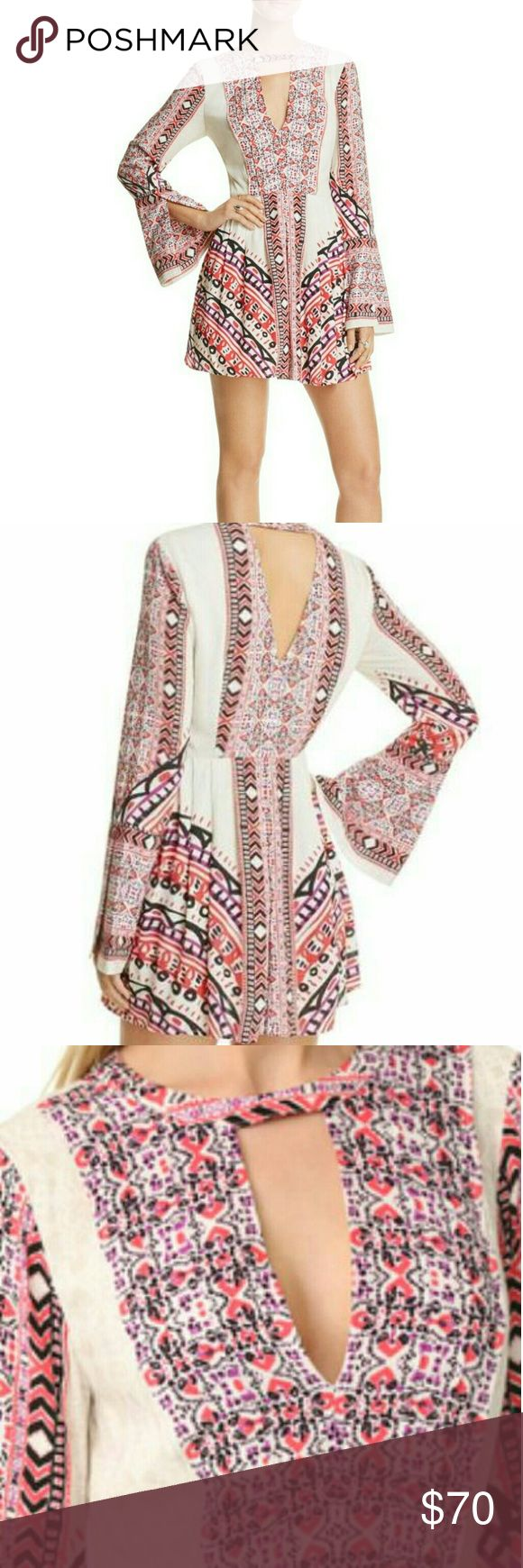 """Free People Tegan Border-Print Mini Dress 10 Ivory Exuding an eclectic, artisanal vibe, Free People's festival-ready mini dress indulges your inner boho babe with a collage of festive tile prints.  Fits true to size, order your normal size  Designed for a loose fit  Round neck, long bell sleeves, slit cuffs, bust cutout  Pleated bib and skirt, concealed side zip closure  Two side slit pockets, button closure at nape, back cutout  Approx. 30"""" from back of neck to hem  Rayon  Machine wash or…"""