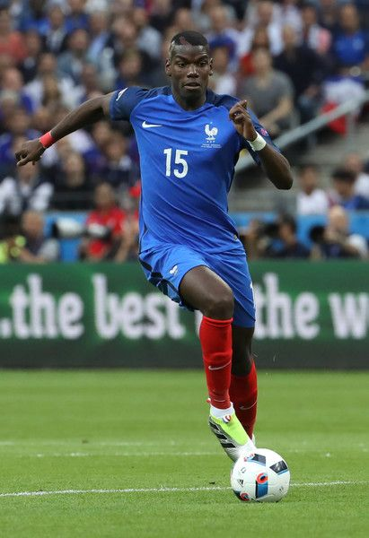 France's midfielder Paul Pogba dribbles the ball during the Euro 2016 group A…