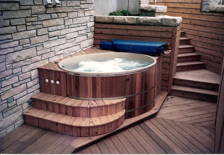 An indoor hot tub. Our small oval and round cedar hot tubs don't require too much space so you can locate them in a basement or sunroom. I love the look of the cedar hot tub, cedar deck and flooring with the stone wall. For more info: http://www.canhottub.com