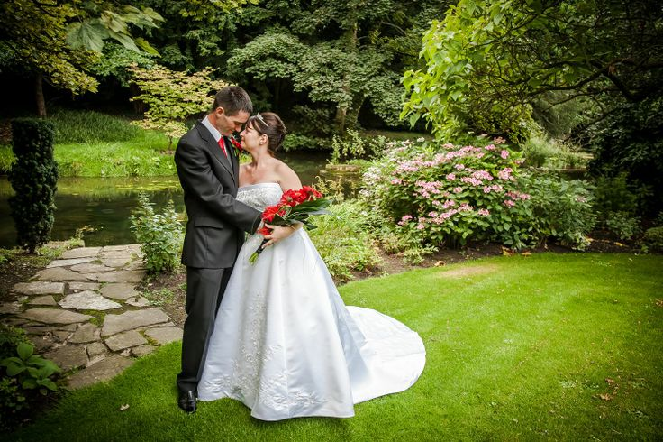 An intimate shot of the bride and groom at the far end of The Orangery's beautiful gardens. (photo re-edited in 2014)