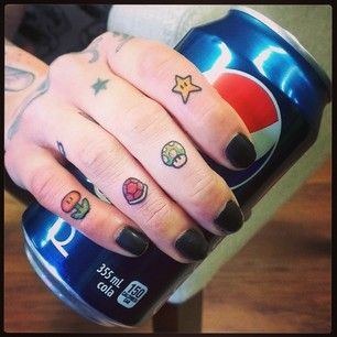Super Mario Knuckle Tattoos | 30 Rad Tattoos Inspired By Nintendo  I wouldn't get them on my knuckles,but I would get a 1up shroom or the Star because their are the best