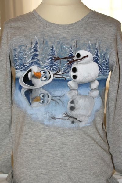 "Hand painted boy's t shirt, featuring Olaf the Snowman, from the movie ""Frozen"", chasing his head on a frozen lake. The colors are non-toxic, water based, permanent fabric colors."