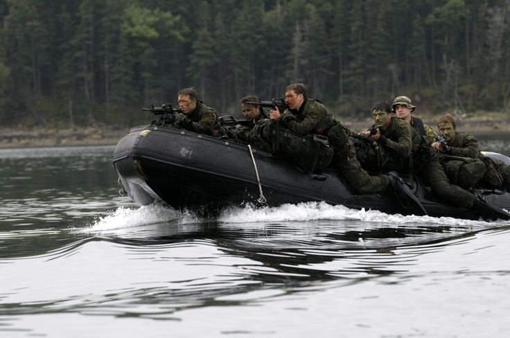 Soldiers on the Patrol Pathfinder course approach a shoreline in a Rigid Hulled Inflatable Boat (RHIB) near Halifax, Nova Scotia July 30, 2013.  Photo by: MCpl David McCord, Canadian Army Public Affairs, 5th Canadian Division  #StrongProudReady