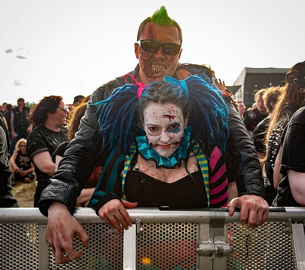 Heavy metal fans having fun at Bloodstock Festival at Catton Park on August 13 2016 in Burton upon Trent England