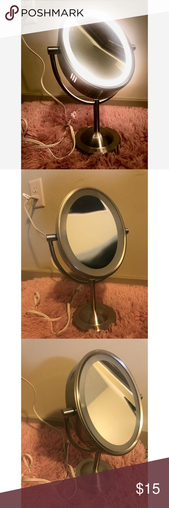 Conair Reflections Lighted Mirror Lighted vanity mirror that plugs in (no batteries needed!)... has regular side and magnified side  Has barely been used and looks brand new Conair Makeup Brushes & Tools