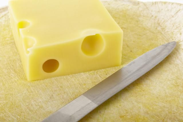 Emmental cheese is a type of Swiss cheese that melts well and features a nutty, buttery flavor. It's one of two main cheeses used for making fondue.